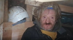 A video grab issued by HS2 Rebellion of a protester known as Digger Down in part of a 100ft tunnel network dug in secret under Euston Square Gardens