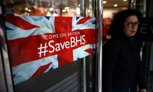A shopper leaves a branch of British Home Stores in London