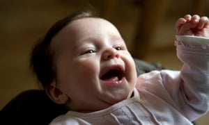 A baby girl laughing with joy.