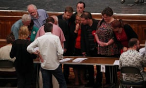 Observers watch ballot papers being counted at the South East region count in Southampton