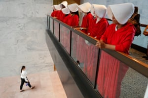 Demonstrators dressed as handmaidens await the arrival of US Supreme Court nominee judge Brett Kavanaugh prior to his appearance before a Senate judiciary committee on Capitol Hill.