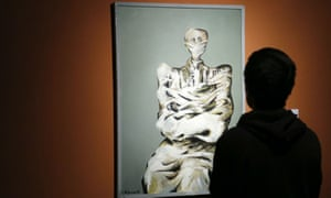 A visitor at the Tehran museum of contemporary art looks at a work by Bahman Mohasses