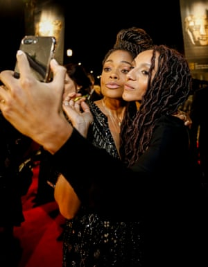 Naomie Harris and activist and journalist Afua Hirsch take a selfie on the red carpet