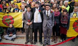 Anti-fracking protesters (from left ) Richard Loizou , Richard Roberts and Simon Roscoe-Blevins with supporters outside Preston crown court.