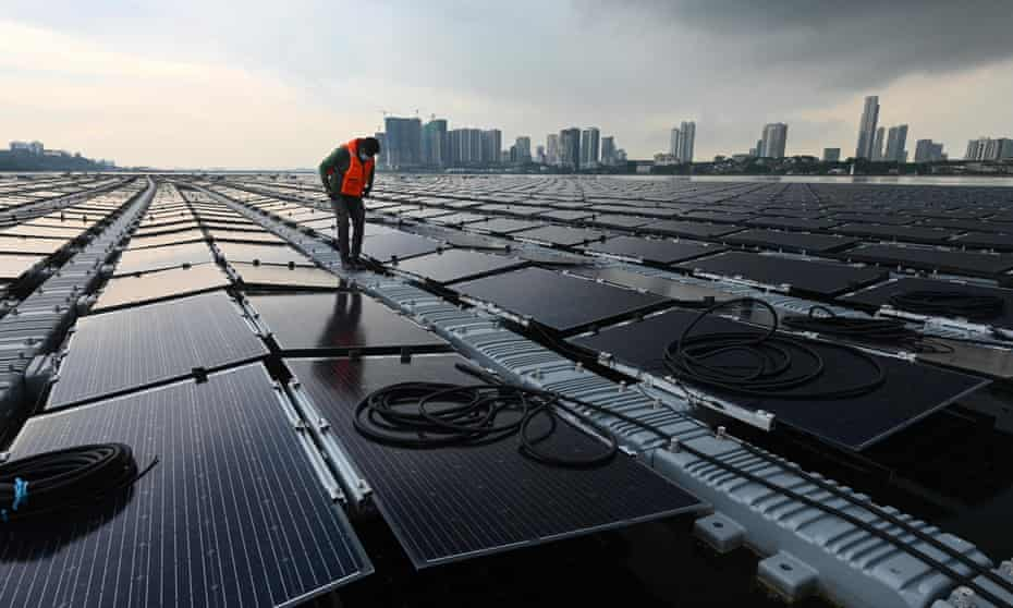 A worker on a floating solar power farm, off Singapore's northern coast, 22 January 2021.