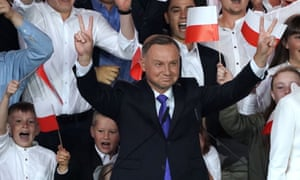 Andrzej Duda gestures to supporters in Pultusk