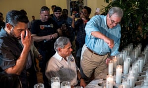 The El Paso mayor, Dee Margo, right, lights candles after the shooting, with Greg Abbot, the Texas governor.
