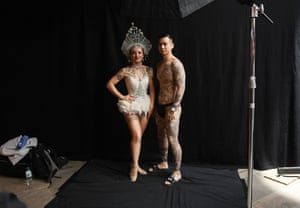 Tattoo enthusiasts pose for photographs