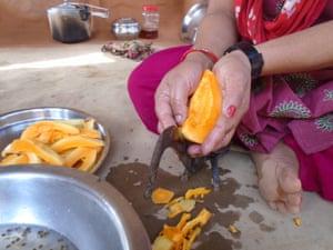Woman cuts papaya, Sindhuli, Nepal
