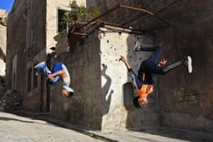 Syrian youths practice parkour in Aleppo.