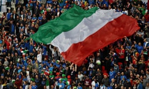 Italy supporters hold up a huge Italian flag at Euro 2016