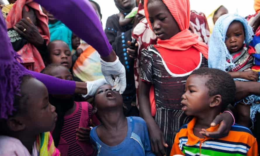 A nurse from the NGO World Vision provides polio vaccination given by the World Health Organization to displaced children in the UNAMID base in Khor Abeche, South Darfur.