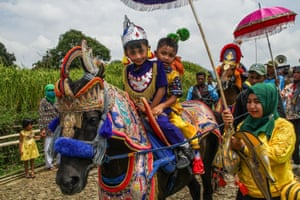 Children ride a Dancing Horse, known locally as a Kuda Renggong during a procession in Tanjungsari, Indonesia