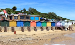 Beach huts on the seafront at Walton on the Naze, Essex, and Hipkins Cafe/tea room