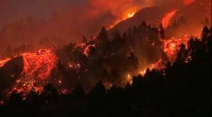 Molten lava pours down the moutain