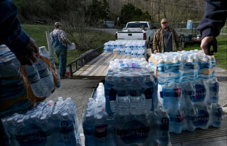 People pick up donated water to share with Martin County community members in Huntleyville, KY on April 1, 2019.
