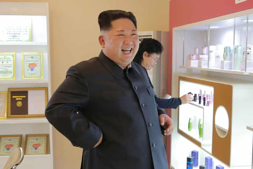 The North Korean leader looks at products in the cosmetics factory.