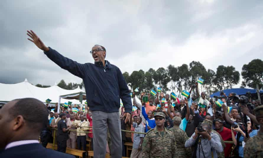 Kagame waves to the crowd before speaking at a baby gorilla naming ceremony in Kinigi, northern Rwanda.