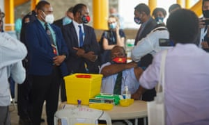 The prime minister of Papua New Guinea James Marape becomes the first in the country to receive a Covid-19 vaccine.