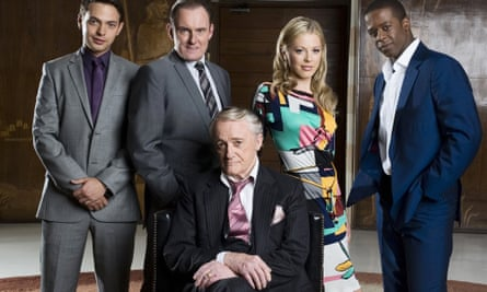Robert Vaughn, foreground, in Hustle (2009) with, from left, Matt Di Angelo, Robert Glenister, Kelly Adams and Adrian Lester.