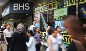 Shoppers pass a BHS store on Oxford Street in London