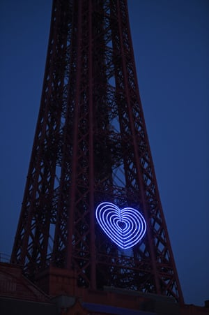 A blue heart is lit up on the Blackpool tower, Lancashire