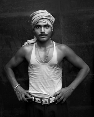 A rickshaw puller poses for a photo.