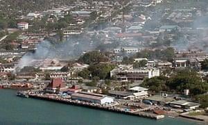 Smoke rises over Dili