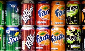 Cans of fizzy drinks on supermarket shelf