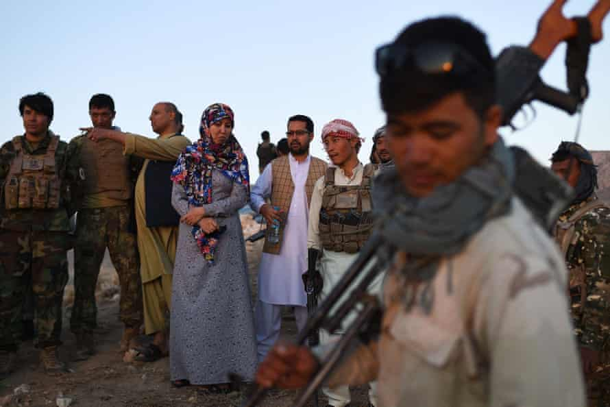 Salima Mazari, fourth from left, with her security detail near the frontline of the battle against the Taliban in Charkint district.