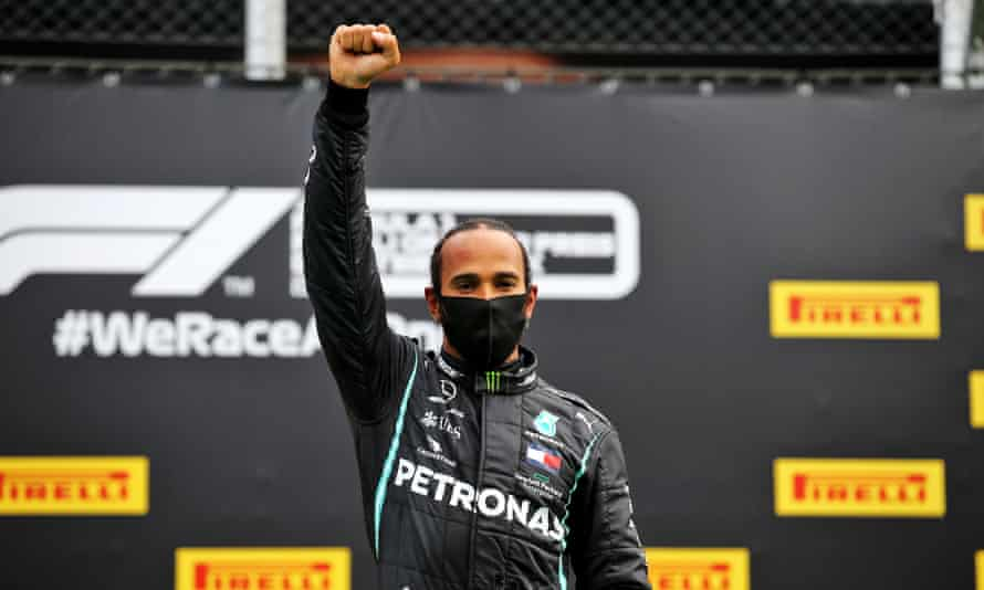 Lewis Hamilton raising his fist in a Black power salute before the Styrian Grand Prix in Austria in July 2020.