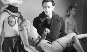 Salvador Dalí holding an artist's lay figure (the chauffeur in the Taxi pluvieux), International Exhibition of Surrealism, Paris, 1938.
