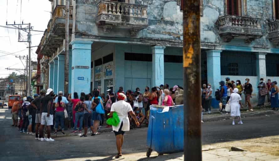 Cubans queue to buy food in Havana.