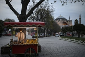 A street vendor waits for clients near the iconic Hagia Sophia, in the historic Sultan Ahmed district of Istanbul Tuesday, 13 April, 2021.