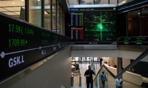 Big screens and a ticker in the main entrance at London Stock Exchange, which is now being courted by its Hong Kong rival