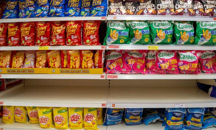 An empty shelf in the crisps section in a Sainsbury's store.