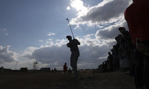 Tiger Woods plays out of the rough on the 14th hole during a practice round at Carnoustie.