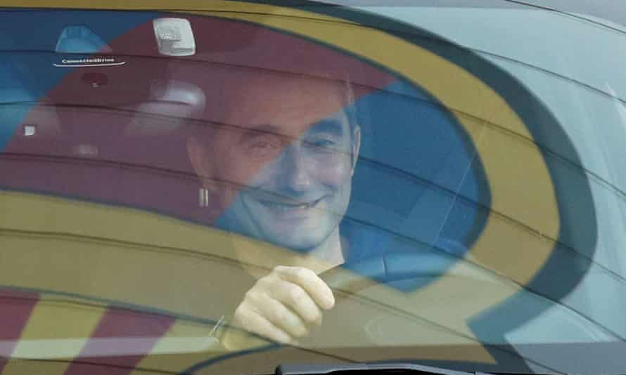 Ernesto Valverde smiles as he drives away from Barcelona's training ground after being sacked on 13 January 2020