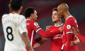 Liverpool's Diogo Jota celebrates with his teammates after scoring his side's third goal.