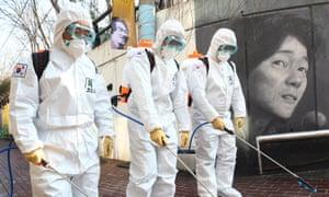 Soldiers disinfect Kim Kwang-seok Memorial Street, a famous tourist spot, in Daegu, South Korea.