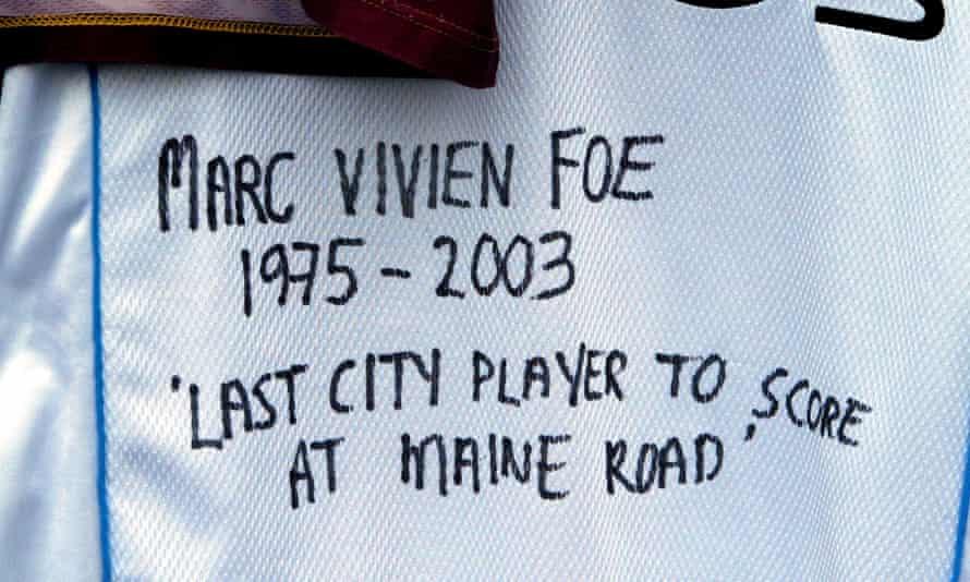 A Manchester City fan's tribute to Marc-Vivien Foe hangs outside Maine Road in 2003.