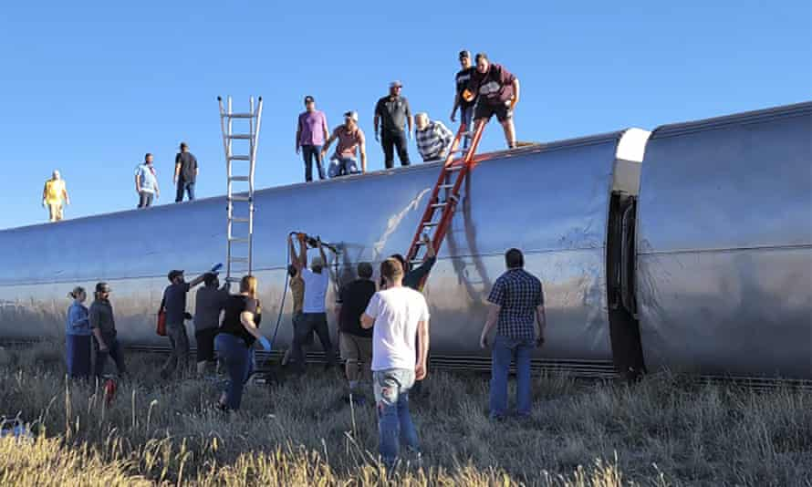 People work at the scene of the train derailment in Montana