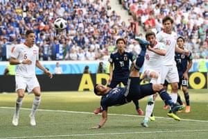 Tomoaki Makino of Japan attempts an overhead kick.