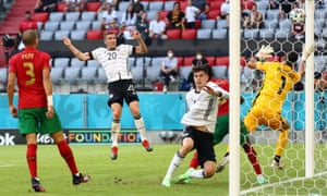 Germany's Robin Gosens heads home their fourth goal.