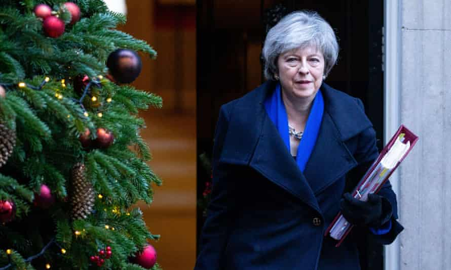 Theresa May leaves Downing Street for prime minister's questions at the House of Commons on 19 December.