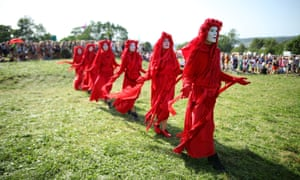 Extinction Rebellion and Greenpeace stage a climate change march on the second day of Glastonbury.