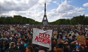 People demonstrate in Paris on Saturday over the death of George Floyd.