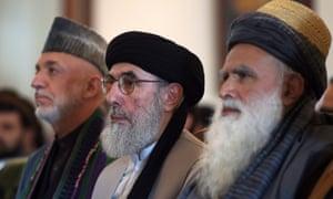 Gulbuddin Hekmatyar, centre, alongside ex-Afghan president Hamid Karzai, left, and former mujahideen leader Abdul Rasul Sayyaf