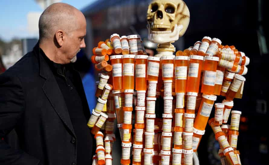 Frank Huntley looks at his sculpture made out of the opiod pill bottles he got when addicted, in February.