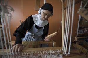 Sister Gunilla works on a loom